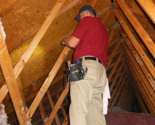 Home Inspector checking the attic
